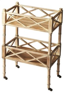 A versatile and unique piece, this mobile server can be used for entertaining or storage purposes. The server features a Driftwood finish and has two shelves with open fretwork surrounding all sides.. The antique brass casters provide easy mobility.