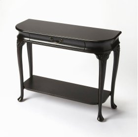 The classic Butler Ridgeland Console Table features a meticulously applied Black Licorice finish . Stylized cabriole legs are graced with intricate carvings, a single drawer with antique brass-finished hardware provides convenient storage.