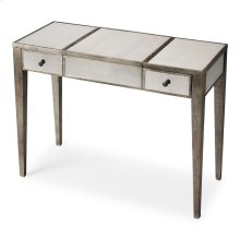 This glamourous vanity with mirrored top, front and sides and complementary pewter trim, square tapered legs, makes a strong style statement while providing abundant storage. It offers two drawers, plus a storage compartment beneath the hinged center lid.