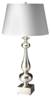 This elegant table lamp will brilliantly light any space. Featuring an antique silver finish, it is hand crafted from aluminum with an iron harp and cotton shade. Product Image