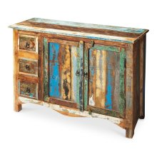 Crafted from assorted recycled wood solids and hand painted with a sense of childlike Crayola abandon, this compelling Sideboard serves up the exuberant cacophony of a soaring spirit. The piece boasts abundant storage behind two doors and inside three dra