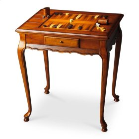 Selected solid woods and choice cherry veneers. Reversible game board inset top, one side chess/checkers and the other backgammon. All game pieces provided including cribbage and cards. Drawer with antique brass finished hardware.