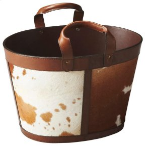 Combining a powerful 1-2 punch of high fashion and optimal functionality, this Magazine Basket features features hair-on-hide upholstery with rich leather handles and trim... plus abundant storage space.