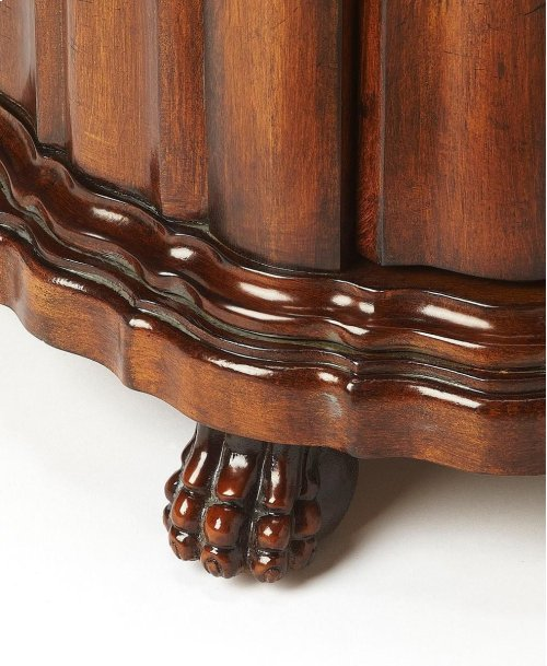 Selected solid woods, wood products and choice veneers. Hand carved details. Maple, walnut and cherry veneers inlay top with oak veneer border. Door with antique brass finished hardware.