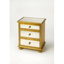 This glamourous chest with mirrored top and front and complementary gold leaf finished trim, makes a strong style statement while providing abundant storage. It offers three drawers. Hardware is finished in sophisticated antique brass. Crafted from hardwo