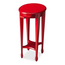 This bold red accent table is hand crafted from poplar hardwood solids and wood products. Perfectly proportioned to sit beside an easychair or serve as a bedside table, it features a matched birch veneer top with a birch veneer lower shelf and pull-out dr