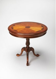 This round pedestal table features a flawless design that enhances your room décor. The inlaid Cherry, Maple, and Walnut veneer, top gives this table a traditional look. The table has a pedestal base with three curved feet and beautiful carved details.