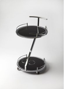 This ultra-modern Gigi serving cart is made out of Black Nickel chrome. The black tempered glass shelves are a great place to display your food and beverages. The tray table is supported by a wine rack for your best vintages.