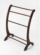 This charming transitional blanket stand is a practical addition in any living room, bedroom, or bathroom. Made from rubberwood and poplar hardwood solids, it boasts arched side supports with hand-carved appointments in a vibrant Plantation Cherry finish. Product Image