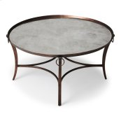 Subtle elegance is what this cocktail table is all about. Together with a smoked mirror inset top, its antique copper finished metal frame is a delightful complement to virtually any style. Hand crafted from metal, it is sure to be the center of attention