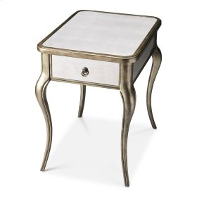 This graceful mirrored side table is sure to be a gorgeous addition to any space. Exquisitely crafted from poplar hardwood solids and wood products, it features an antique mirrored glass top with matching mirrored inlays on its side aprons, back and drawe