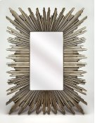 This mirror can certainly serve as a focal point for any room. With its striking silver frame in a modified start burst pattern, this mirror will wow your guests as it hangs over your mantle or in your entryway. Product Image
