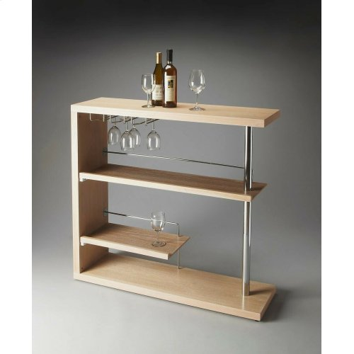 Crafted from select solid woods and wood products with a stylish metal post and wine-glass holders, this sleek Bar Cabinet features a contempoary Gray Dawn Finish.
