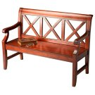 """This alluring transitional bench is a welcome addition to a variety of spaces. Crafted from select hardwoods and wood products, it features bold """"X back supports and a mysterious, lightly distressed Plantation Cherry finish. Product Image"""