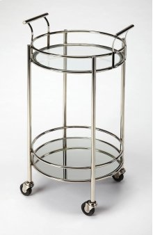 Serve cocktails with this haute modern serving cart. Its forged round stainless steel frame has a polished finish supporting a tempered glass shelf on the top and a mirrored glass shelf below. Four large casters ensure easy mobility from one room to the n