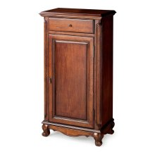Selected solid woods and wood products. Two adjustable shelves behind door. One drawer. Antique brass finished hardware.