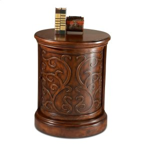 Selected solid woods, choice veneers and wood products. Maple veneer top and sides. Maple veneer door with carved overlays revolves open to reveal inside shelf. Antique brass finished hardware.