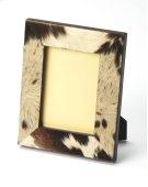 Leather and cowhide picture frame with a spotted motif. Product Image