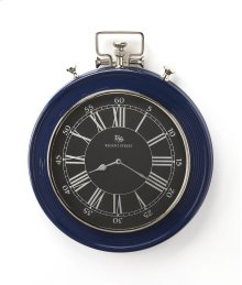 This wall clock is crafted in a round blue frame that features Roman & traditional numerals over a white face, and a sturdy handle. The clock can be placed on any wall and blends with a variety of decor. Makes a great gift.