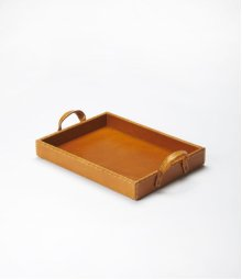 This modern serving tray is certain to be the finishing touch in your space. Featuring a luxurious leather surface, it is hand crafted from mdf,leather, pvc .