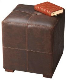 This versatile leather ottoman with a button-tufted cushioned top functions nicely as a stand-alone piece, or can be used in multiples either in front of a sofa or as extra seating when entertaining. The frame is made from hardwood solids and wood product