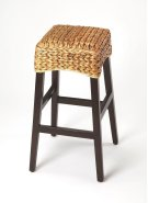 Enhance your kitchen, bar or work space with this transitional rattan barstool. Crafted from gemelina wood solids with a dark brown wood stain, it features a square hand woven banana rattan seat in a natural finish. Product Image