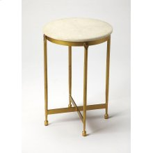 This imitable round end table is a classic design and a lovely addition in the living room or bedroom. It features a cool white marble top that is beautifully supported by an iron base comprised by four legs and an X stretcher in an antique brass finish.
