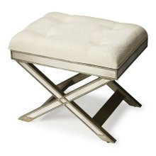 This striking vanity stool is a glamorous addition to virtually any space. Big on look with antique finished mirror inlays on its apron and X legged base, it functions beautifully in a bedroom or powder room as a stool, or as an ottoman in other living sp