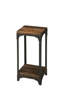 Hand-crafted from iron and solid acacia wood, this distinctive pedestal stand is small in stance, yet rugged in appearance. Its black iron frame and burnt umber wood finish on the top and lower display shelf complement each other well.