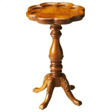 Designed to be a perfect complement for a small space in virtually any room, this elegant table is crafted from solid hardwoods with olive ash burl veneers. Tabletop features a distinguished scallop edge atop an immaculately turned pedestal and four legs