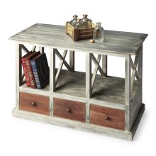 Boldly combining brown wood tones on the drawer fronts with a gray driftwood patina overall gives this table a compelling sophistication - distressed and antiqued. Crafted from mango wood solids and wood products, the table offers substantial storage and
