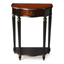 This charming console was designed for small spaces - perfectly suited for a hall, entryway or stairway landing. Hand painted in black and crafted from poplar hardwood solids and wood products, it features a rich, contrasting, hand rubbed cherry veneer to