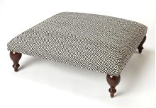 Use this simple yet stylish ottoman as a seat or as a footstool. With its very wide surface area, it can also be used as a makeshift coffee table. Its short, dark brown Mango wood solid legs support a very stylish black-and-white diamond design Urethane f