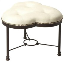 Featuring a trefoil shaped seat, with button-tufted detail and nail head trim; this fanciful vanity stool brings charming appeal to your master suite or powder room.