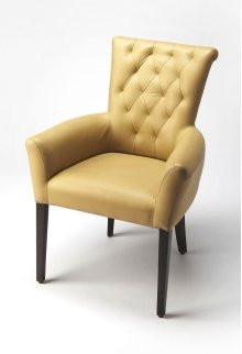 A modern addition to your reading nook or den' The Cosmopolitian accent chair features button tufted back, rounded arms, all clad in leather for comfortable quiet moments .