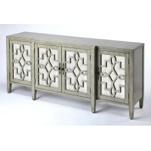 Perfect addition to just about every dining room or living area; a storage friendly sideboard. This traditionally styled sideboard boasts of majestic influences with a contemporary appeal. The overall dimensional design is embraced with the soft curves of