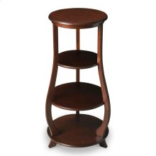 Two adjustable shelves plus top and base provide abundant display possibilities on this elegant etagere. It is handcrafted from poplar and wood products with cherry veneers in a warm Nutmeg finish.