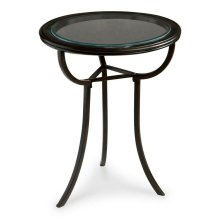 The handsome accent table pairs classic design with contemporary flair. Finished in rich black, this flowing silhouette highlights curving metal legs and a beveled glass top perfect for showcasing lush floral arrangements or resting your favorite glossy m