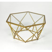 Artful on its own or displaying a vintage trinkets, this eye-catching cocktail table featuring a geometric design and gold finish, this table brings contemporary appeal to your library or living room.