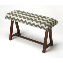 This bench will stylishly enhance your space. Featuring a primitive aesthetic, it is crafted from Mango wood solids with a zig zag cotton fabric.