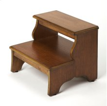 """This traditionally styled bed step keeps everything within reach, and its sturdy construction is a """"step-up from other options. Crafted from select hardwood solids and wood products, it features a charming distressed finish over cherry veneers. Beyond the"""