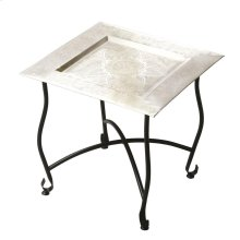 Inspired by a traditional Moroccan tea table, this tray table is embellished with a traditional design on its aluminum serving tray. The lightweight aluminum tray nests securely in the base, and the aluminum base folds flat for easy storage. This piece is