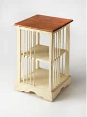 """Is it a bookcase or is it a table"""" It is both! Timeless in its inspiration, this bookcase table is crafted from mahogany wood solids and features a two-tone finish of cream below with a crackled mahogany top resembling crusty bread. Product Image"""