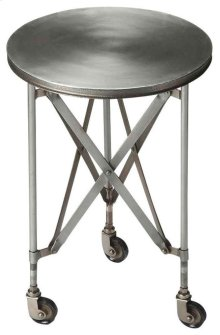 Crafted from iron on iron casters, this platinum hued industrial chic accent table evokes the charm of a by gone era. This table features a distinctive interlaced base linking legs and table top.