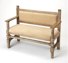 This distinctive bench is perfect in an entryway, living room or any space where extra seating is desired. Featuring turned legs, posts and a front stretcher with hand carved details in a Driftwood finish, it is crafted from poplar and rubberwood solids,
