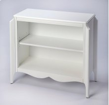 The multi-dimensional design with its soft curve lines and destinctive leg shape of this bookcase offer a crafted treasure for every room. The scalloped design appeal of the bottom wood trim is adourned by the shape of the soft curves of the dimensional l