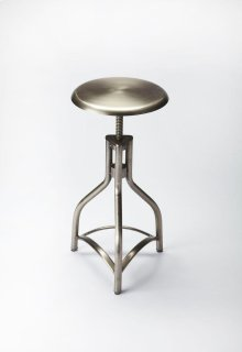 This aluminum oxide finished bar stool will stylishly enhance your space. Featuring an industrial chic aesthetic, it is hand crafted from iron.