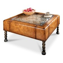 An instant heirloom, this unique cocktail table will be the focal point of any space. Featuring a distinctive Old World map laminate that is glazed and lacquered to ensure years of beauty and utility, the top inset boasts a working clock beneath a beveled