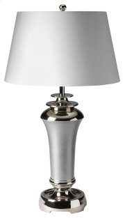This modern table lamp will brilliantly light any space. Featuring a nickel finish, it is hand crafted from aluminum with an iron harp and cotton shade. Product Image