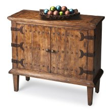 The bold whale-tail hardware, door pulls and three rows of tacks across the door fronts establish the compelling aesthetic for this exceptional console cabinet. Expertly handcrafted from gmelina solids, wood products and maple veneers, and heavily distres